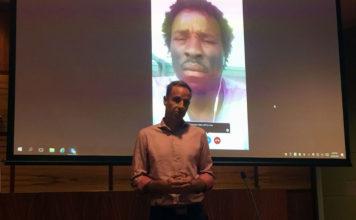 Senator Nick McKim & Abdul Aziz Adamn speaking live on Skype, Photo taken by Mary Hakimi_2