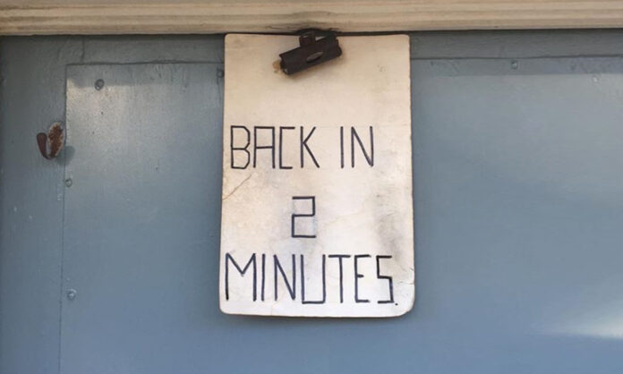 Back in 2 minutes sign