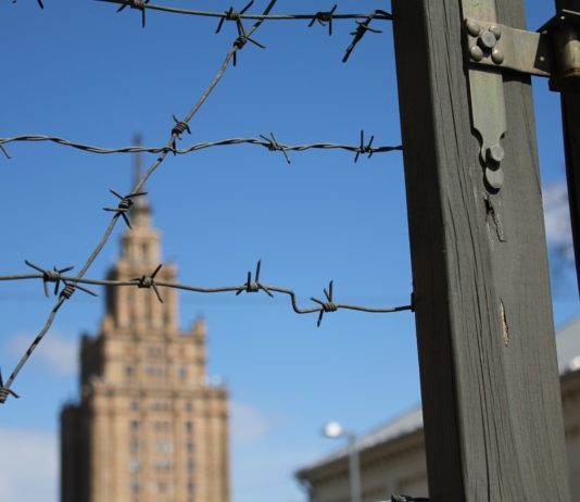 Barbed wire fence and buildings