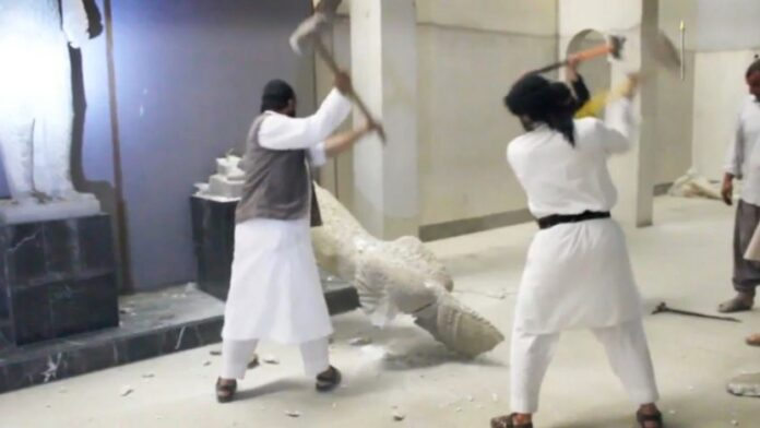 Figure 1. Screenshot of disseminated, reposted, and viral YouTube video of ISIL militants destroy two statues of kings from the ancient city of Hatra in the Mosul Museum.